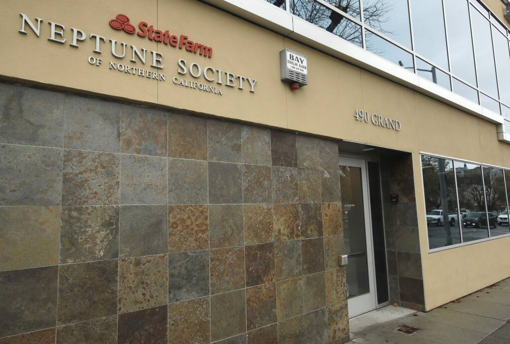 Neptune Society of Northern California office front is seen in Oakland, Calif. California's attorney general is suing Neptune Society, claiming the well-known company pocketed $100 million that it should have kept in reserve for those who signed up for its prepaid cremation service plans. California Attorney General Xavier Becerra and three county prosecutors alleged Monday, Dec. 2, 2019, that as a result, many customers failed to get their full refunds if they canceled their contracts. The suit also says the company falsely claimed to use its own crematoriums when in fact it contracted with others. (AP Photo/Ben Margot)
