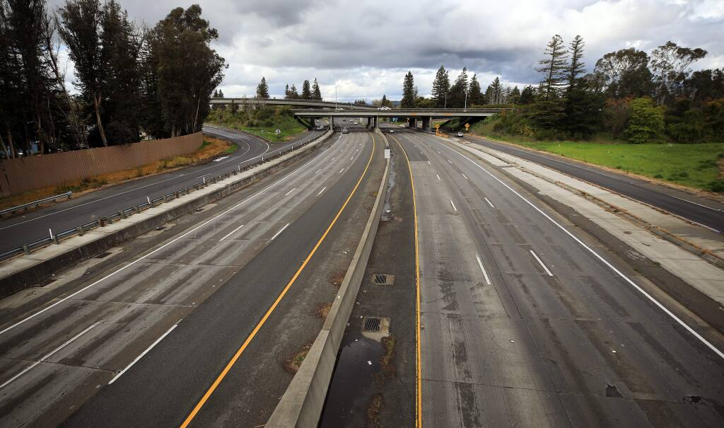 Highway 101 is almost empty of commute traffic at the Highway 12 interchange, Tuesday, March 24, 2020 in Santa Rosa. (Kent Porter / The Press Democrat) 2020