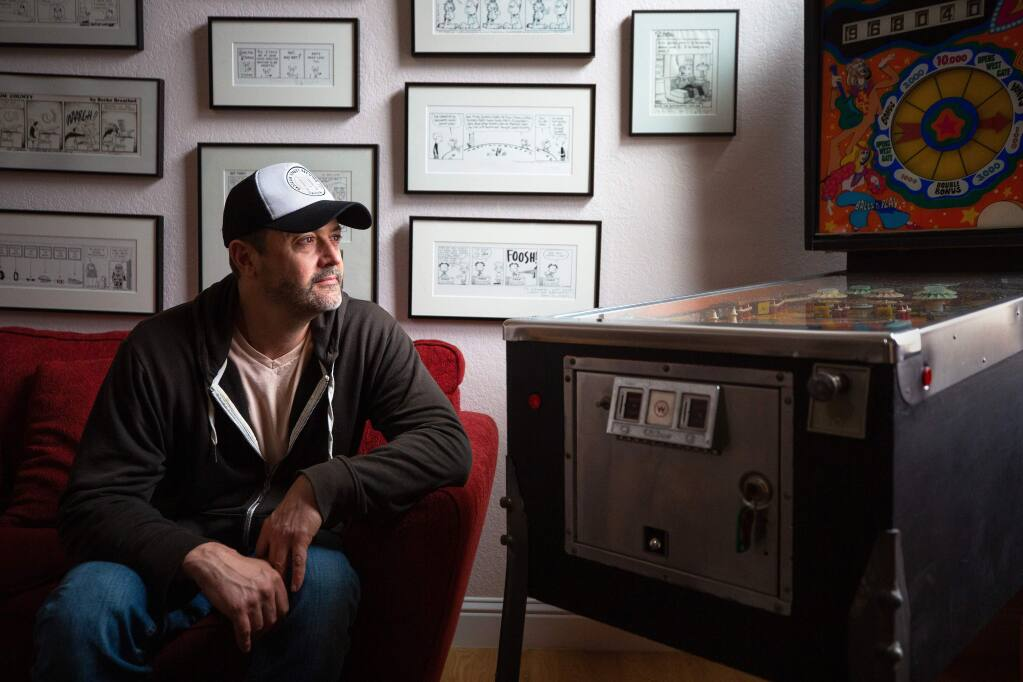 """Cartoonist Stephan Pastis, creator of the nationally syndicated """"Pearls Before Swine"""" comic strip, poses for a portrait at his studio in Santa Rosa in 2020. (Alvin A.H. Jornada / The Press Democrat)"""