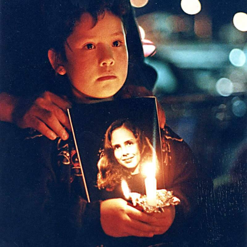 Lizeth Lopez holds a candle and photo of Polly Klaas at a vigil outside the Polly Klaas Search Center in Petaluma on Saturday night December 4th 1993, after is was announced that Polly Klaas's body was found.