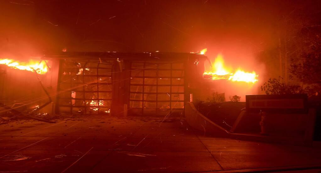 Santa Rosa fire station 5 burns above Fountaingrove in Santa Rosa, Monday Oct. 9, 2017. (Kent Porter / Press Democrat) 2017