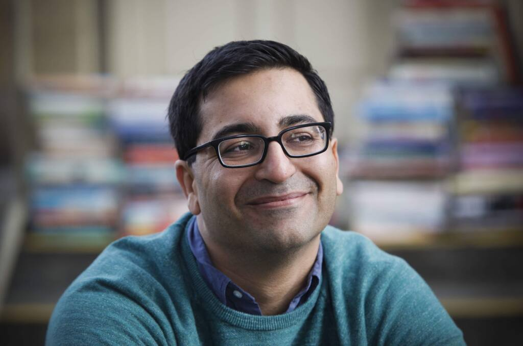 """Petaluma, CA, USA. Monday, December 05, 2016. _ Petaluma-based freelance photographer Ramin Rahimian's recently launched an iOS app as a """"buy local' alternative to Amazon and eBay. """"Bookal"""" is a new smartphone app that lets neighbors easily buy and sell books from each other. (CRISSY PASCUAL/ARGUS-COURIER STAFF)"""