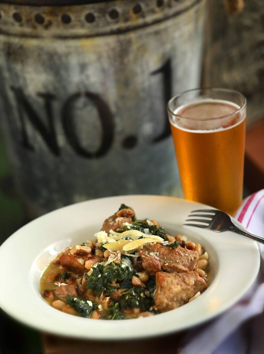 Pork and Heirloom Beans combines braised pork, rancho gordo heirloom yellow eye beans and greens from the Gypsy Cafe in Sebastopol. (John Burgess/The Press Democrat)