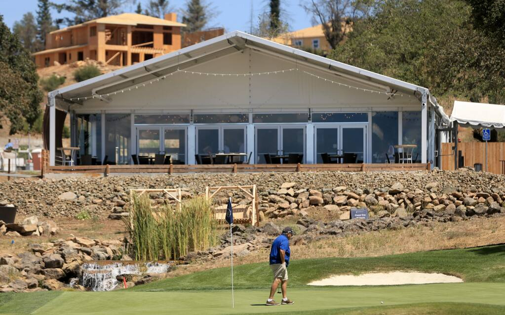 The Fountaingrove Club in Santa Rosa suffered substantial losses due to the Tubbs fire, but a structure called the Sunset Grill was built, sandwiched between the driving range and the ninth hole, Thursday, Aug. 22, 2019 in Santa Rosa. (Kent Porter / The Press Democrat) 2019