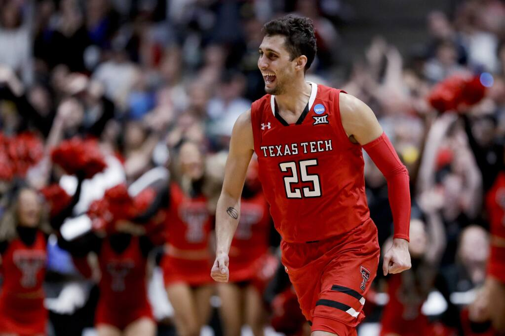 Texas Tech guard Davide Moretti celebrates after scoring against Gonzaga during the second half of the West Region final in the NCAA Tournament, Saturday, March 30, 2019, in Anaheim. (AP Photo/Marcio Jose Sanchez)