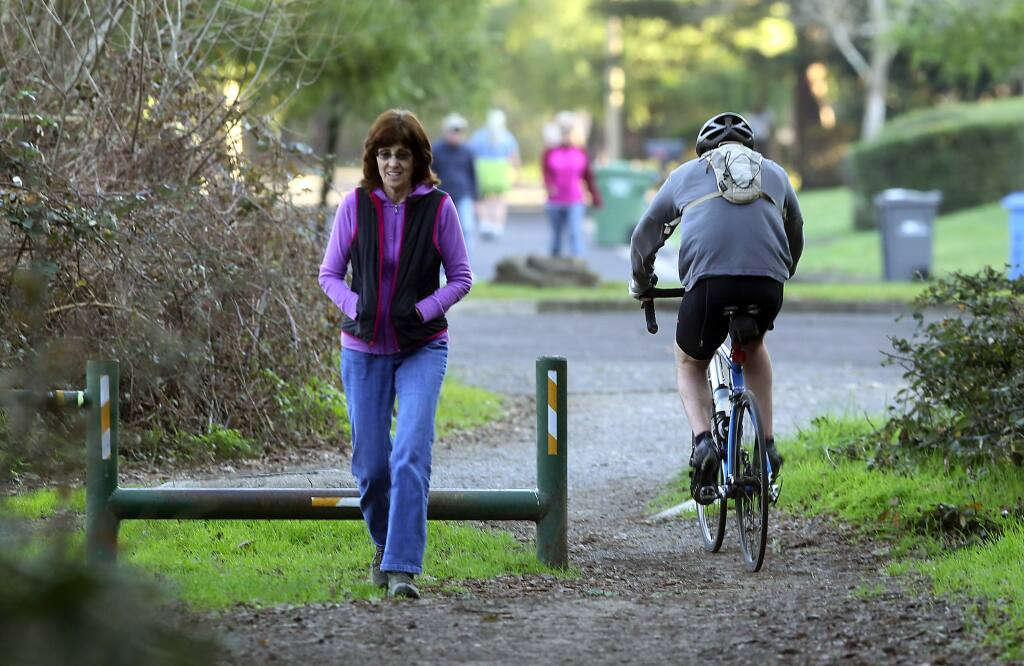 A biker heads out of Annadel State Park to Timber Springs Drive in the Wild Oak subdivision in Oakmont. (JOHN BURGESS/ PD FILE, 2015)