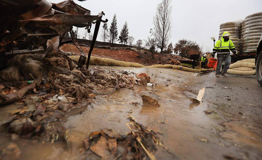 A small debris flow pushes from a cleared lot on Heathfield Place, Monday Jan. 8, 2018 in Fountaingrove, due to rainfall. (Kent Porter / The Press Democrat) 2018
