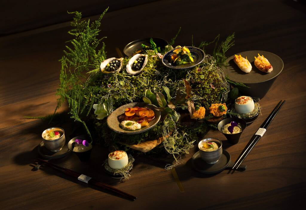 Photos by John Burgess / The Press Democrat)An array of dishes are presented on a bed of wood, moss and ferns at Single Thread Farm-Restaurant-Inn, the new upscale Japanese restaurant in Healdsburg.