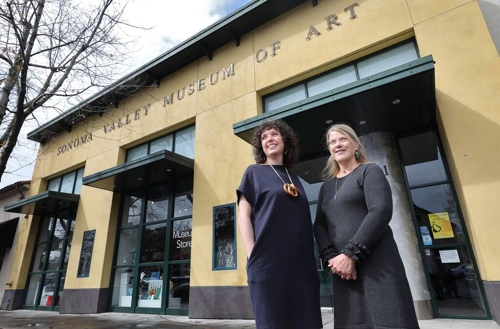 Tanya Gayer, left, exhibitions manager, and Margie Maynard, deputy director of engagement and exhibitions, co-curated the Sonoma Valley Museum of Art's exhibit devoted to the 2017 wildfires. (Christopher Chung/ The Press Democrat)