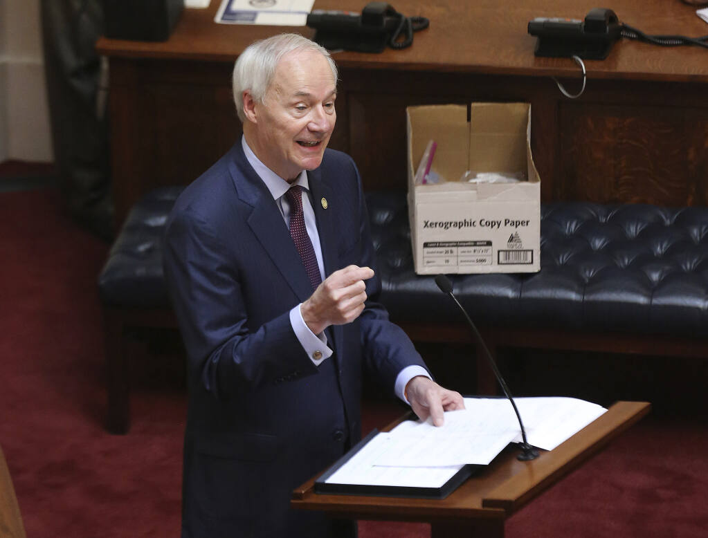 Arkansas Gov. Asa Hutchinson gives the State of the State on April 8, 2020, in the senate chamber of the state Capitol in Little Rock, Arkansas. Hutchinson vetoed legislation that would have made his state the first to ban gender confirming treatments for transgender youth, but today the legislature overrode that veto. (Tommy Metthe / Arkansas Democrat-Gazette)