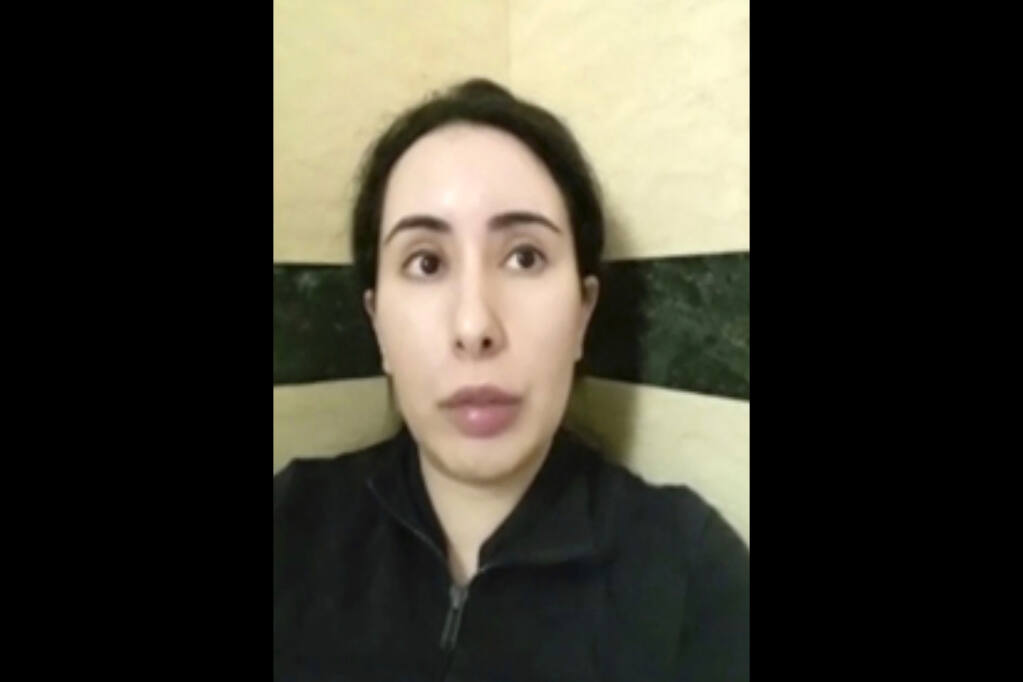 """FILE - This undated file image taken from video in an unknown location shows Sheikha Latifa bint Mohammed Al Maktoum speaking into a mobile phone camera. Sheikha Latifa, who has been the subject of concern from a United Nations panel after being seized trying to flee the sheikhdom in 2018, appeared in a social media post Monday, June 21, 2021, that described her as being in Spain on a """"European holiday."""" (#FreeLatifa campaign, Tiina Jauhiainen/David Haigh via AP, File)"""