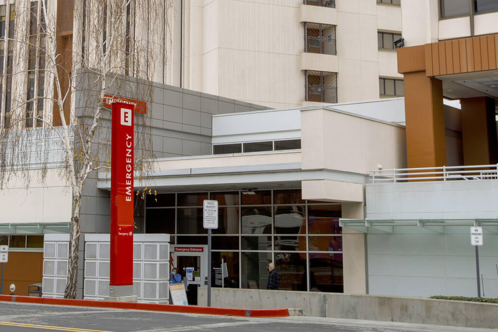 The emergency entrance at the Kaiser Permanente San Jose Medical Center is shown in San Jose, Calif., on Saturday, Jan. 2, 2021. A Kaiser Permanente employee is dead and dozens of workers have contracted the coronavirus after a staffer appeared at a Northern California medical center wearing an inflatable, air-powered holiday costume on Christmas Day, the hospital and health care company said Monday, Jan. 4, 2021. (Anda Chu/Bay Area News Group via AP)