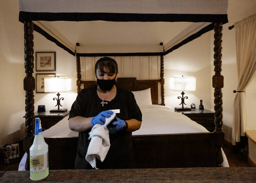 With many guests coming through, housekeeper Maria del Carmen Rodriguez is kept busy cleaning and disinfecting a suite at the Fairmont Sonoma Mission Inn in Boyes Hot Springs on Friday, August 13, 2021. (Photo by Robbi Pengelly/Index-Tribune)
