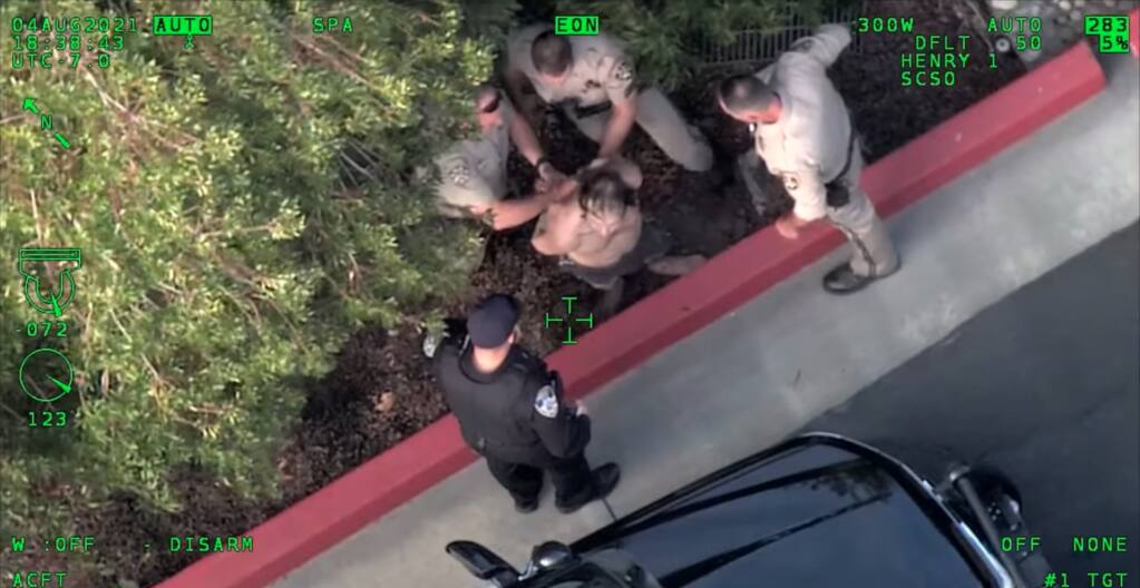 A video taken from the Sonoma County Sheriff's Office helicopter Henry 1 shows police arresting a DUI suspect who hid in a storm drain after running from the scene of a car crash on Highway 101 in Petaluma, California on Wednesday, Aug. 4, 2021. (Sonoma County Sheriff's Office/Facebook)