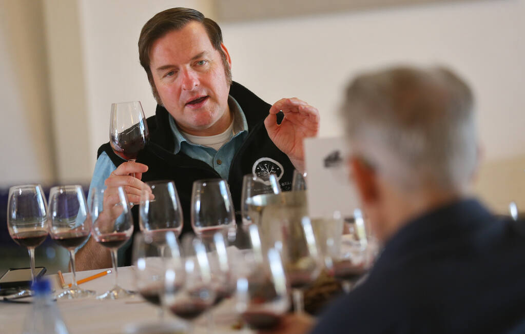 Christopher Sawyer talks about a wine during Sonoma County Harvest Fair Wine Competition judging at the Sonoma County Fairgrounds in Santa Rosa on Tuesday, Sept. 14, 2021.  (Christopher Chung/ The Press Democrat)