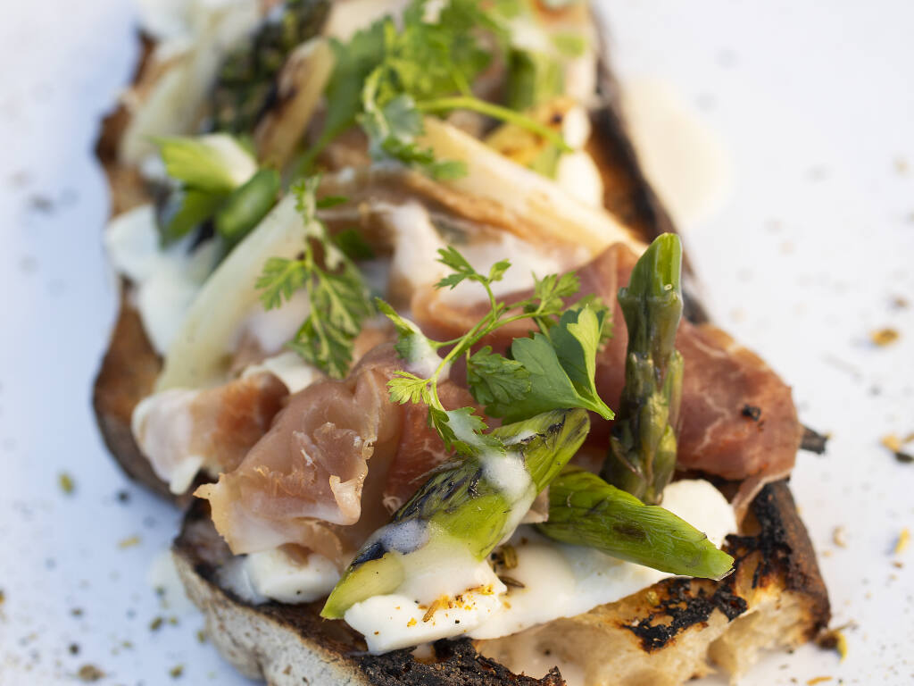 Roasted Veggie Toast appetizer with asparagus, prosciutto and pine nuts over sage Straus cream from Wit & Wisdom Sonoma.  (John Burgess/The Press Democrat)