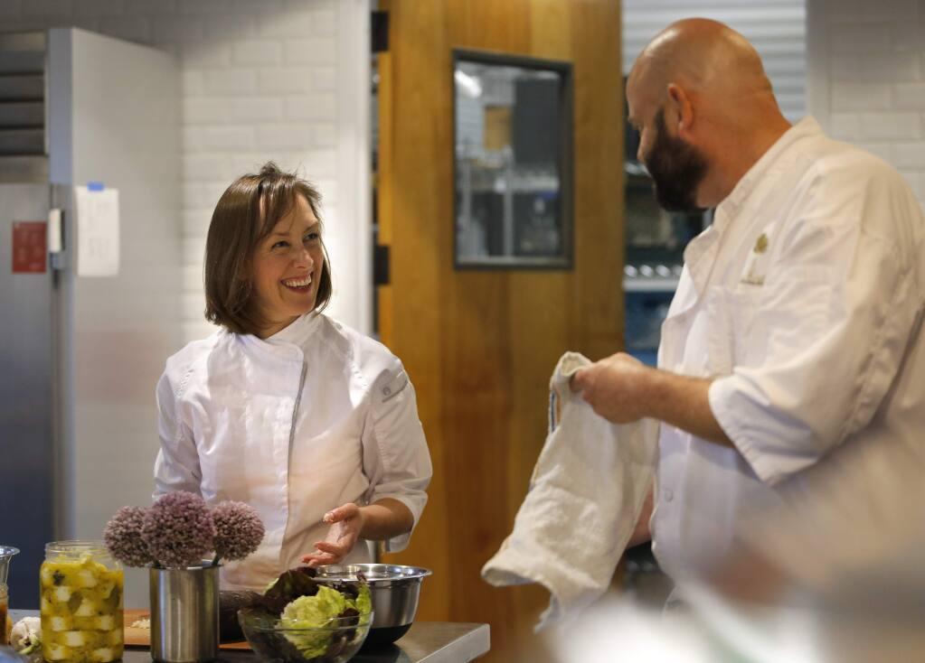 Ciara and Chris Greenwald cook together at Bay Laurel Culinary in Petaluma. (Beth Schlanker/The Press Democrat)