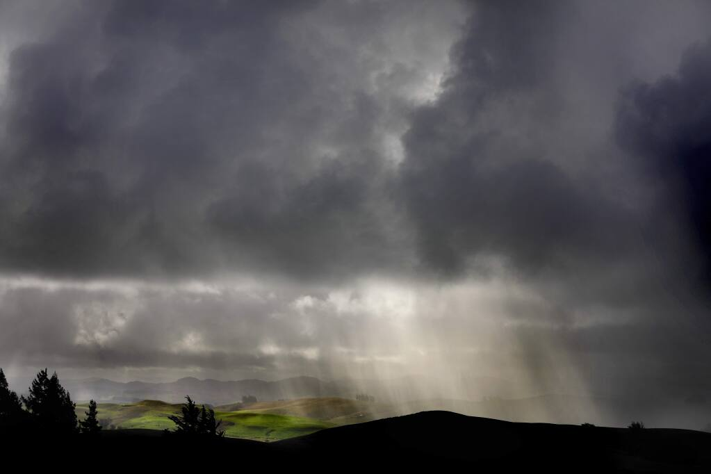 The sun shines through clouds and a light rain shower in Sebastopol on Thursday, November 29, 2018. (BETH SCHLANKER/ The Press Democrat)