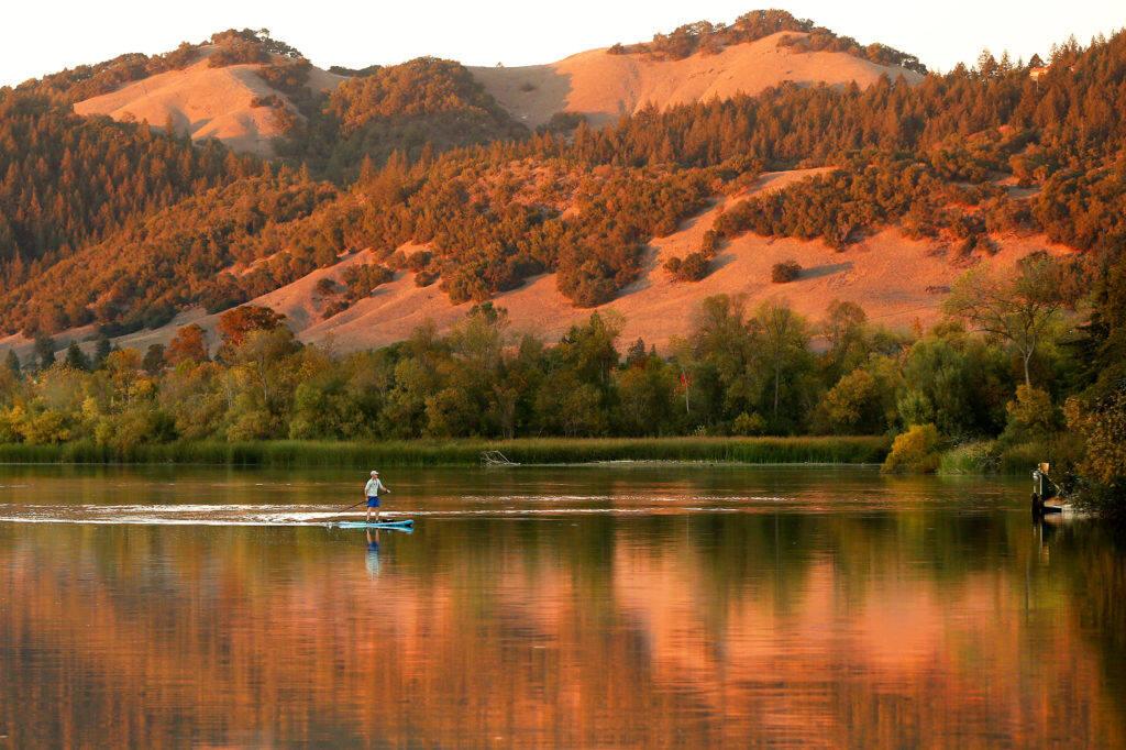 A paddleboarder rows around Spring Lake in Santa Rosa in 2018. (Alvin A.H. Jornada / The Press Democrat)