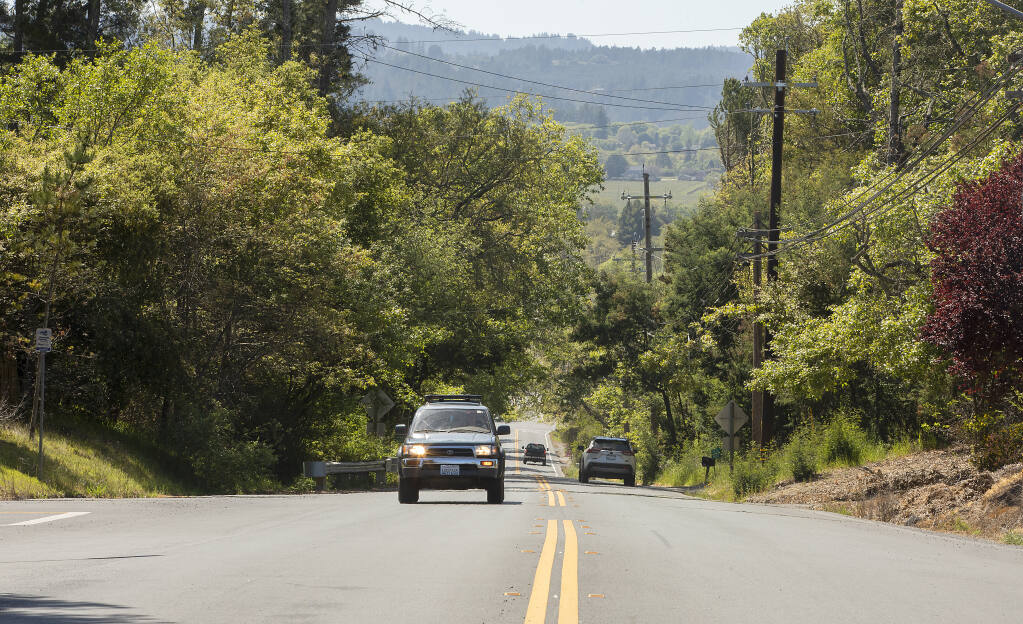 The town of Graton is proposing to truck in  4,000-gallon loads of wastewater six times a day from Occidental to a receiving station on the corner of Green Valley road and Hicks road, at about the location of the SUV driving east on Green Valley road in this photo. Occidental's sewage is presently trucked to Windsor, but Graton hopes to increase revenue in their underutilized sewage plant. Photo taken on Wednesday, April 14, 2021. One long-term solution to the issue that is under consideration is the construction of a pipeline. (John Burgess/The Press Democrat)