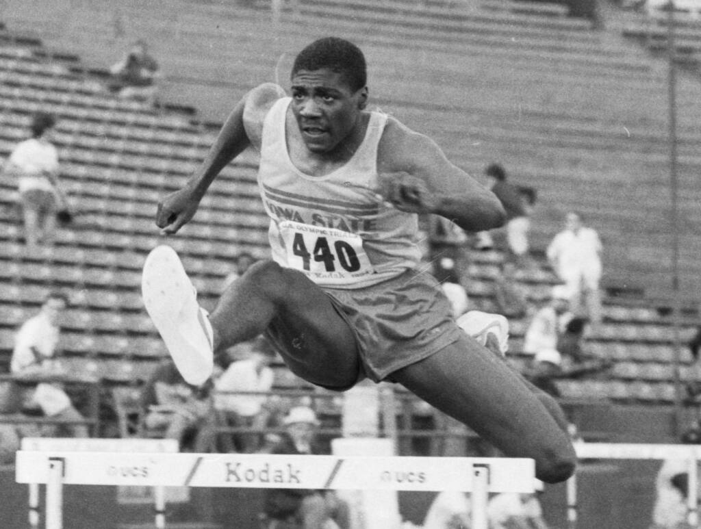 FILE - In this June 18, 1984, file photo, Iowa State University's Danny Harris, of Perris, Calif., clears a hurdle on his way to a second place finish in the men's 400-meter hurdles during the U.S. track and field trials in Los Angeles. Harris earned silver in the 400-meter hurdles at the 1984 Olympics in Los Angeles behind legendary hurdler Edwin Moses, who won gold. Harris was charged Tuesday, June 6, 2017, with contacting a teenage girl to commit a sex crime while he was a Southern California high school coach. (AP Photo, File)
