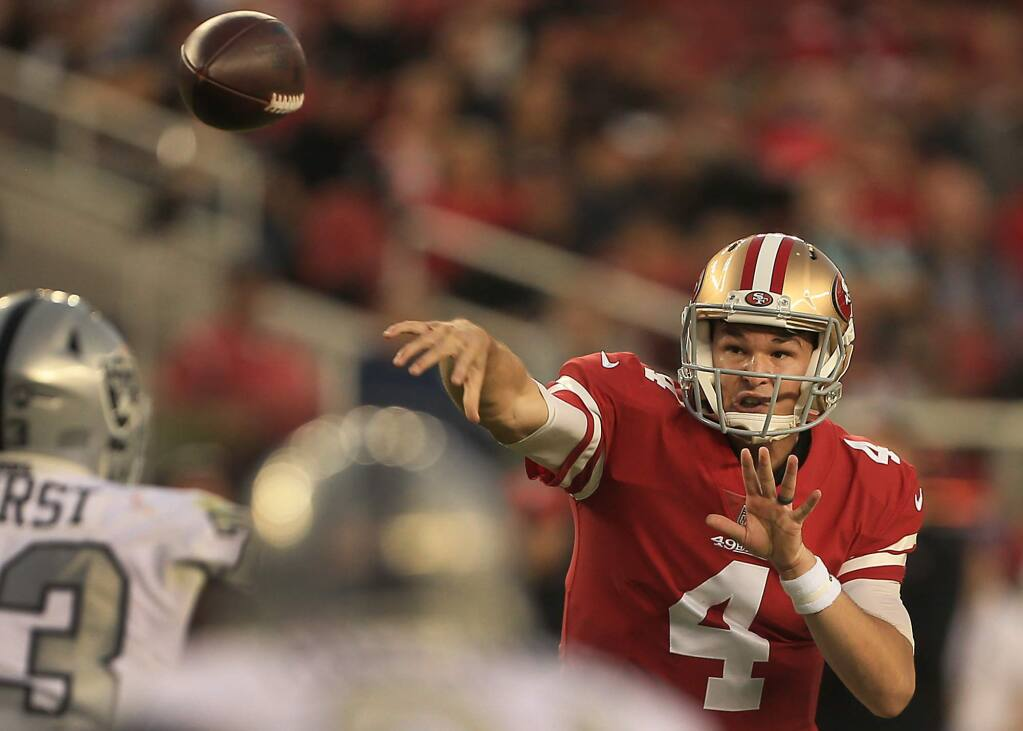 During his first start as quarterback, Nick Mullens throws for a first down in the red zone during the 49ers 34-3 win over the Raiders, Thursday Nov. 1, 2018 in Santa Clara. (Kent Porter / The Press Democrat) 2018