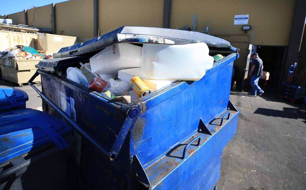 Non-recyclable trash including styrofoam and plastic bags are discarded in a recycling bin behind Pacific Market in Sebastopol on Wednesday, Oct. 17, 2018. (KENT PORTER/ PD)