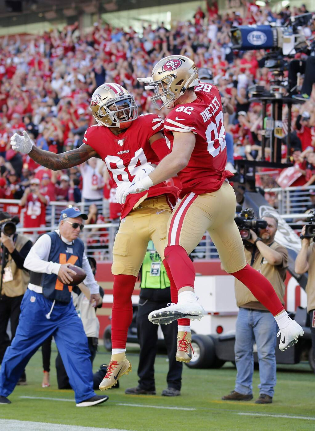 San Francisco 49ers tight end Ross Dwelley, right, is congratulated by wide receiver Kendrick Bourne after scoring against the Arizona Cardinals during the first half of an NFL football game in Santa Clara, Calif., Sunday, Nov. 17, 2019. (AP Photo/Josie Lepe)