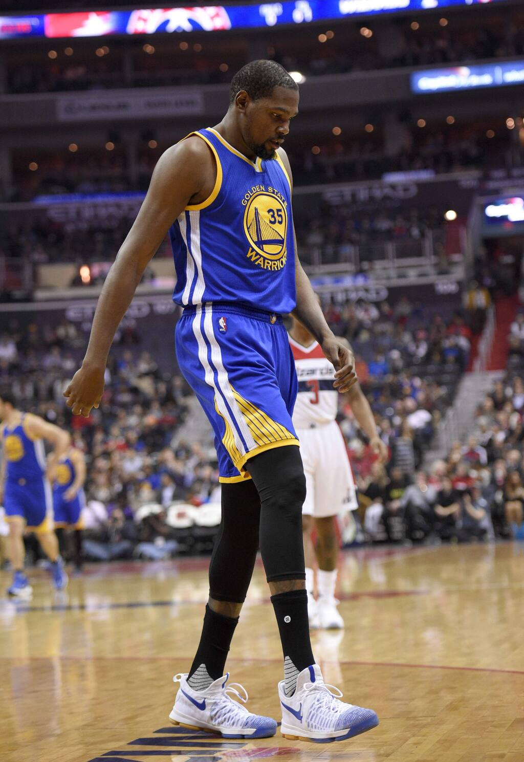 Golden State Warriors forward Kevin Durant (35) walks to the bench during the first half against the Washington Wizards, Tuesday, Feb. 28, 2017, in Washington. Durant hyperextended his left knee and exited the Golden State Warriors' game at the Washington Wizards for good after all of 93 seconds Tuesday night. (AP Photo/Nick Wass)