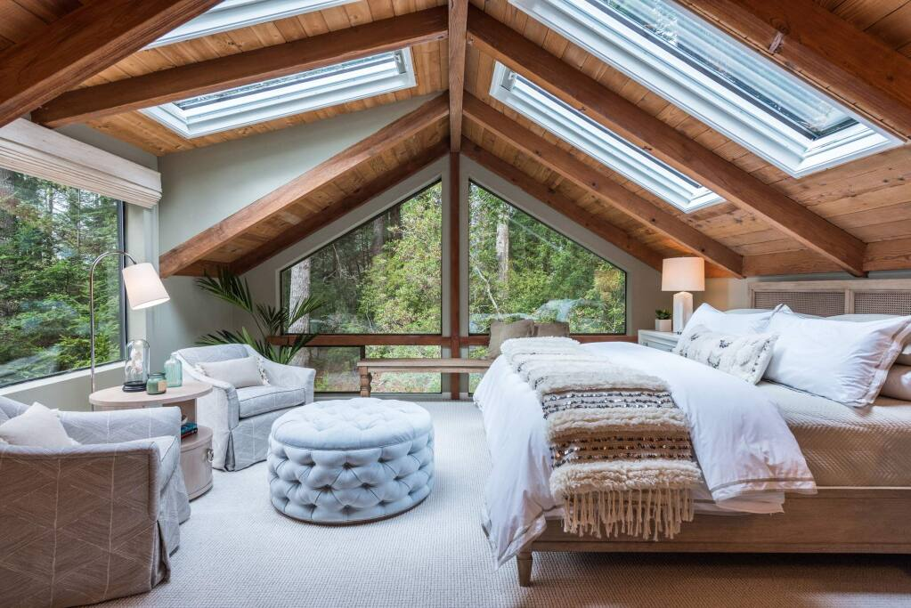 Meredith Gilardoni PhotographyAn interior redesign at a Sea Ranch vacation house on Timber Ridge Road included this upper floor bedroom with plenty of windows.