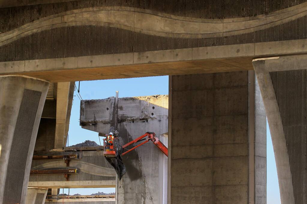 The northbound lanes of the Hwy 101 Petaluma bridge are being demolished. (Photo by John Burgess/The Press Democrat)