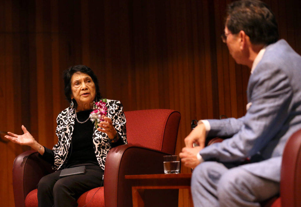 Dolores Huerta, the co-founder of the United Farm Workers of America with Cesar Chavez, joined by President Frank Chong speaks to a crowd at Santa Rosa Junior College in Santa Rosa on Monday, April 22, 2019. (BETH SCHLANKER/ The Press Democrat)