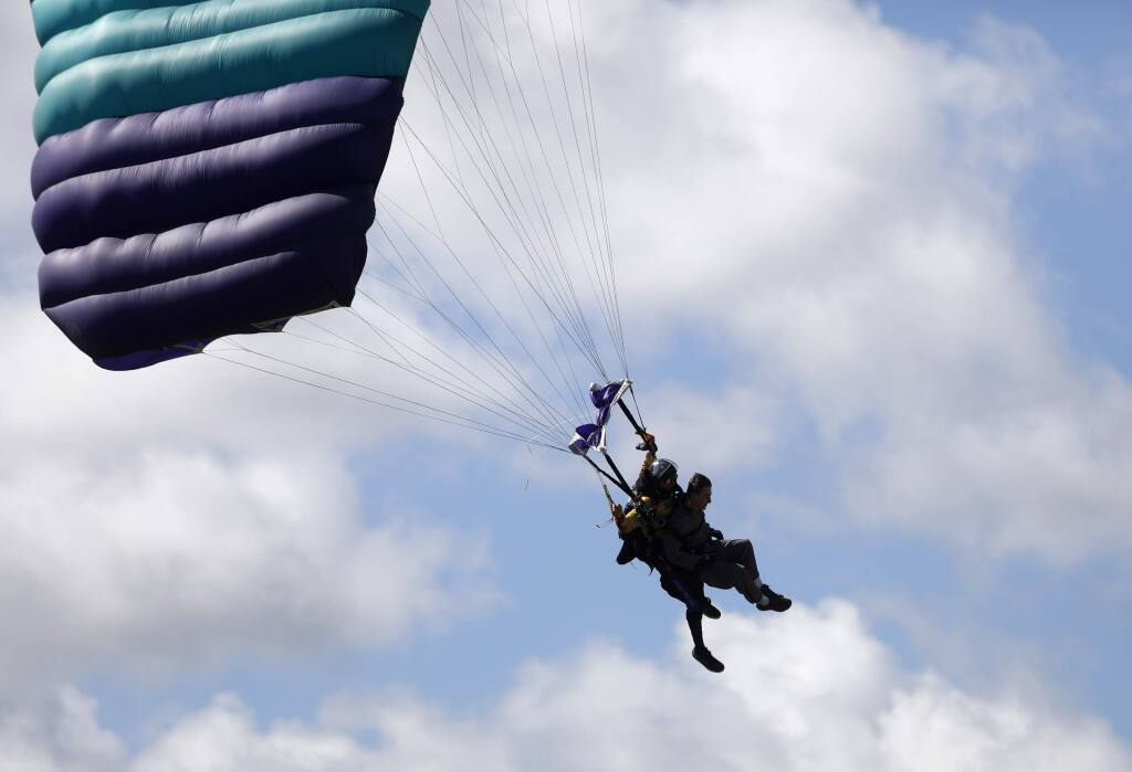 Max Psaledakis, a firefighter with Sonoma Valley Fire and Rescue Authority, skydives with tandem instructor Brad Patterson during a First Responders Appreciation Day hosted by Skydive Golden Gate at the Gnoss Field/Marin County Airport on Sunday, March 25, 2018 in Novato, California . (BETH SCHLANKER/The Press Democrat)