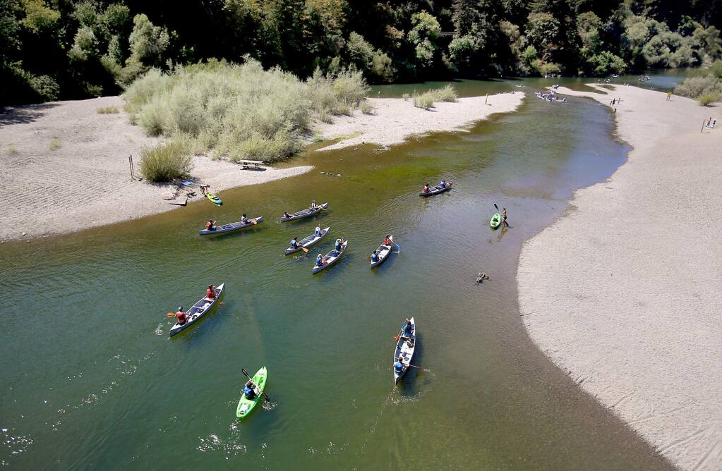 On a pleasant late summer day, canoes are paddled from the Monte Rio beach, Thursday Aug. 27, 2015 on the Russian River. (Kent Porter / Press Democrat) 2015