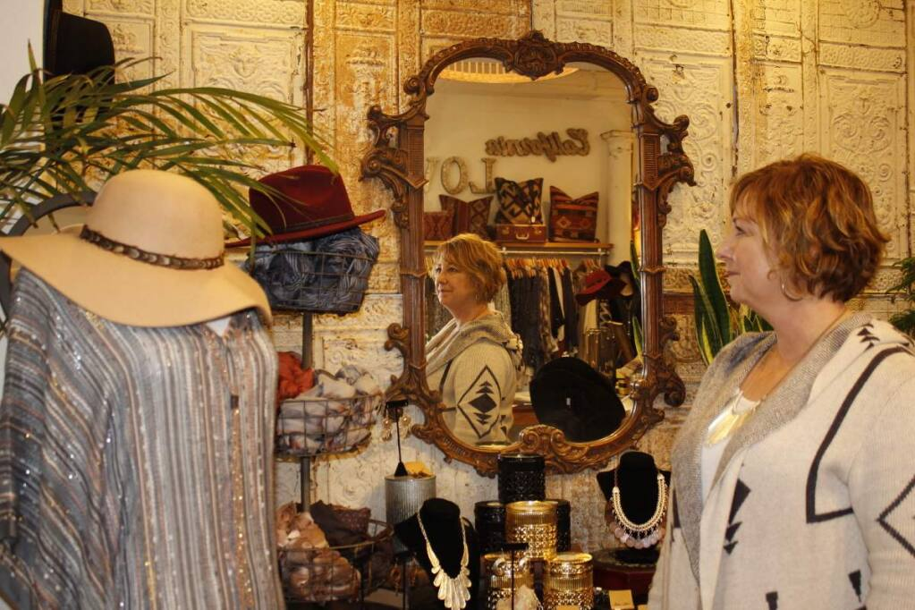 PHOTOS BY ANN CARRANZAShop owner Cindy Holman shows merchandise at Gathered in Healdsburg.