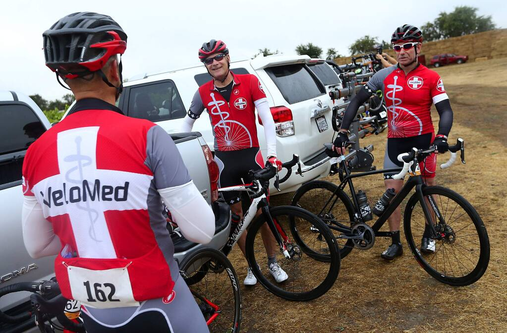 Santa Rosa anesthesiologist and VeloMed founder Dr. David Robertson, center, talks with Dr. Steve Meffert, right, and Dr. Dave Giannetto before the start of the Tour de Fox bike race on Saturday, August 29, 2015. (JOHN BURGESS / The Press Democrat)