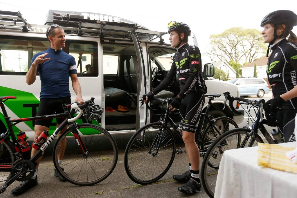 Former professional cyclist Andy Hampsten, left, talks with Team Swift members Riley Mullen, 14, and his sister Lisa Mullen, 12, before embarking on a ride the local cycling team, in Santa Rosa, California, on Tuesday, April 4, 2017. Hampsten is known for being the first American to win the 1988 Giro d'Italia, where he rode over the Gavia Pass during a snowstorm. (Alvin Jornada / The Press Democrat)