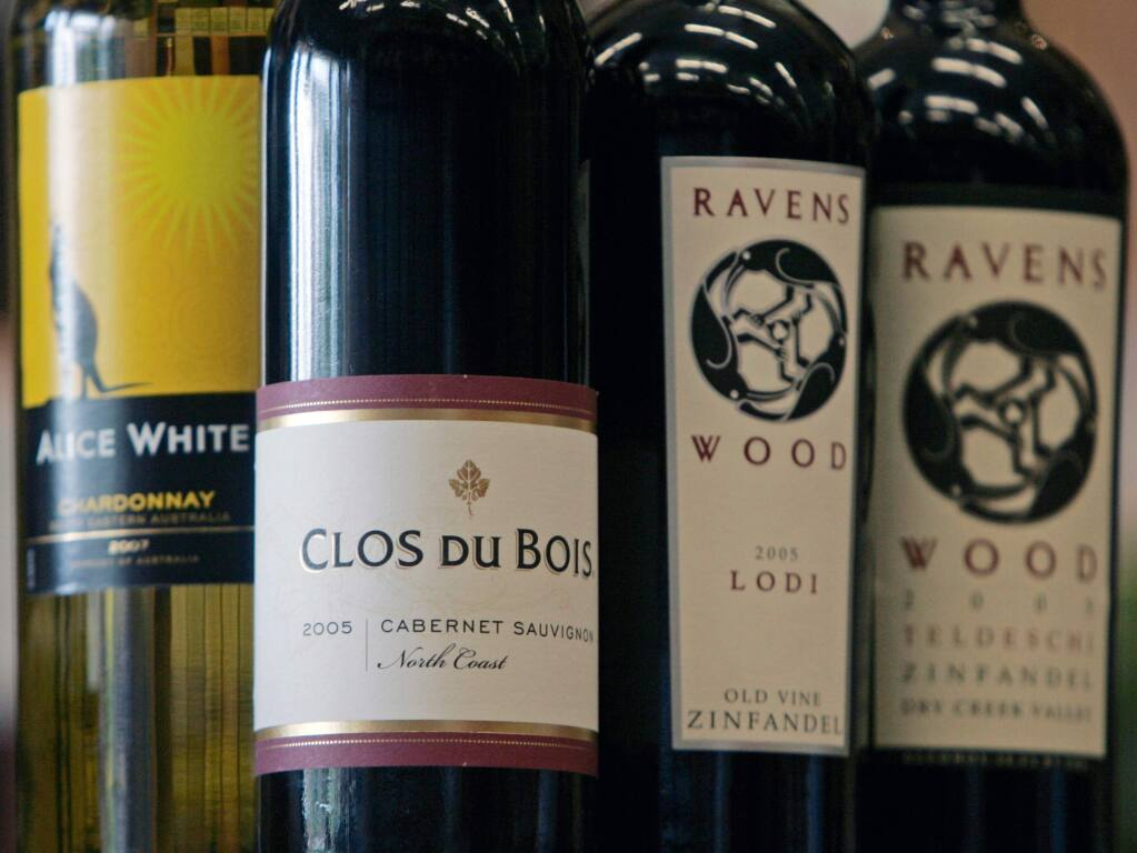 FILE - In this July 1, 2008 file photo, bottles of Clos Du Bois, Ravens Wood and Alice White, wines in the Constellation Brands, are seen at Empire Wine and Liquor Outlet in Colonie, N.Y. Constellation Brands Inc., which markets Mondavi wine, Svedka vodka and Corona beer, said Thursday, Jan. 7, 2010, its third-quarter profit fell 47 percent on restructuring-related costs and weaker U.S. wine sales. (AP Photo/Mike Groll, File)