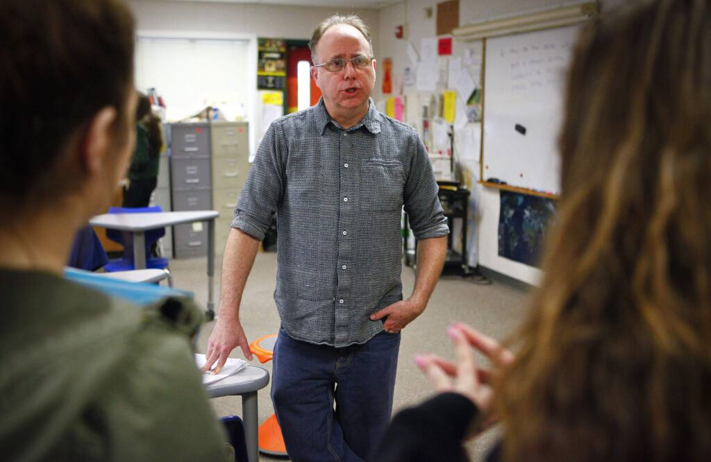 Petaluma, CA, USA. Monday, March 07, 2017._ Todd Siders is a social studies teacher at Casa Grande HS where he teaches 'PEACE' (philosophy, ethics and community engagement). To make ends meet, the 48-year-old divorced teacher and father has to juggle several other part-time jobs including being a driver for Lyft. (CRISSY PASCUAL/ARGUS-COURIER STAFF)