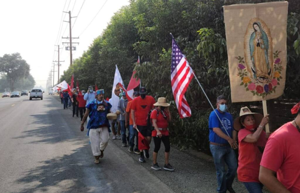 Marchers head to the French Laundry in Yountville on Wednesday, Sept. 22, 2021,  after Gov. Newsom vetoed a bill that would have allowed farm workers to vote by mail in union elections. (United Farm Workers / Twitter)