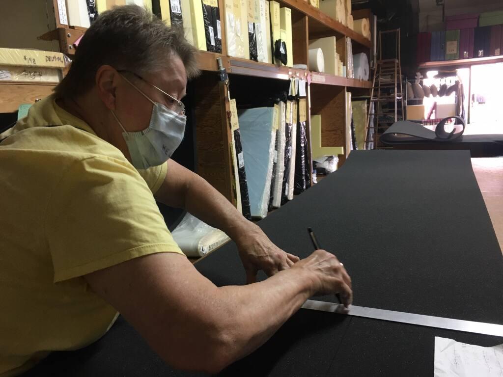 Creator's Foam owner Erin Leonard measures foam before cutting it. (Chris Smith/The Press Democrat)