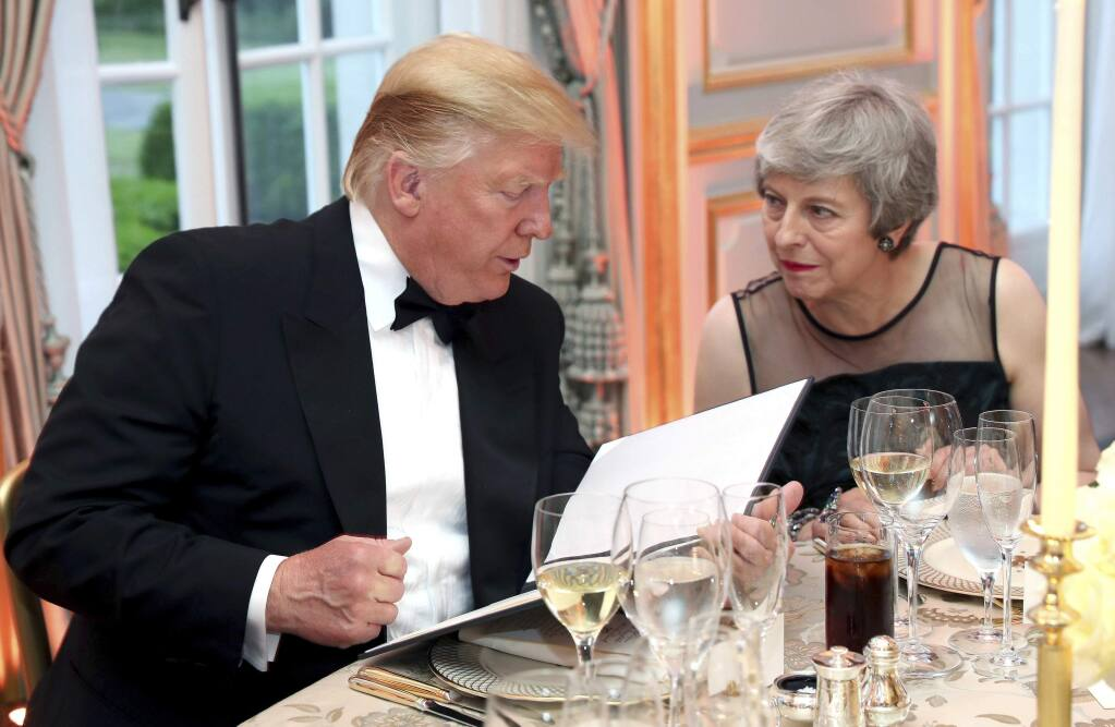 US President Donald Trump and Britain's Prime Minister Theresa May speak during the Return Dinner in Winfield House, the residence of the Ambassador of the United States of America to the UK, in Regent's Park, part of the president's state visit to the UK, in London on Tuesday, June 4, 2019. (Chris Jackson/Pool Photo via AP)