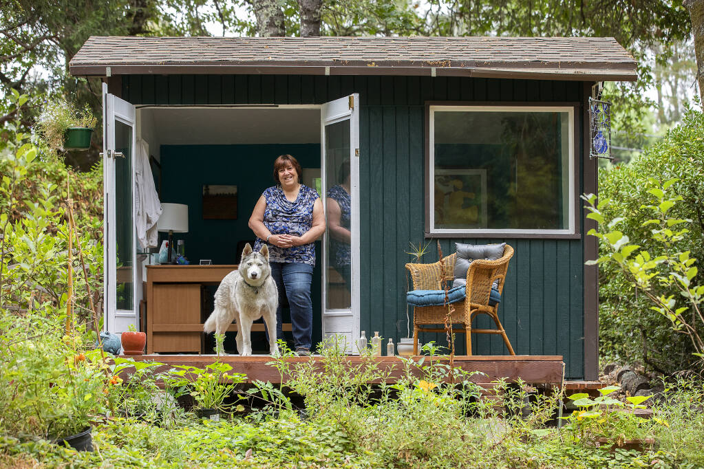 """Writer Rita Sever works in a tiny cottage in the backyard of her Forestville home. Sever just published """"Leading for Justice: Supervision, HR and Culture"""" to help leaders create a more just organization. (Photo by John Burgess/The Press Democrat)"""