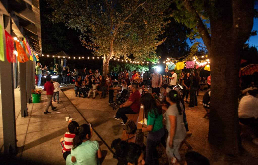 The party outdoors on the patio at La Luz.
