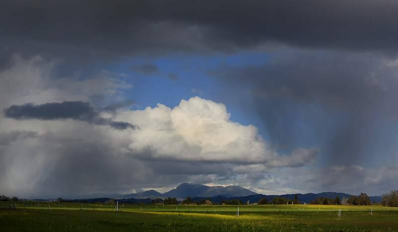(FILE PHOTO) Hailstorms and rain showers roll over the Santa Rosa Plain with Mount St. Helena in the background, Tuesday Feb. 19, 2013. (Kent Porter / Press Democrat) 2013