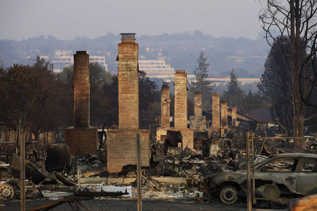 A row of chimneys left standing in a Santa Rosa neighborhood devastated by the Tubbs fire. (JAE C. HONG / Associated Press, 2017)