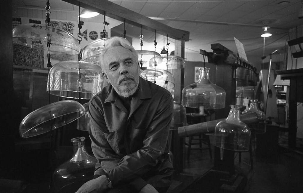 Harry Partch with his Cloud-Chamber Bowls and Spoils of War instruments in his Petaluma studio in 1964. (Bruce Harlow)