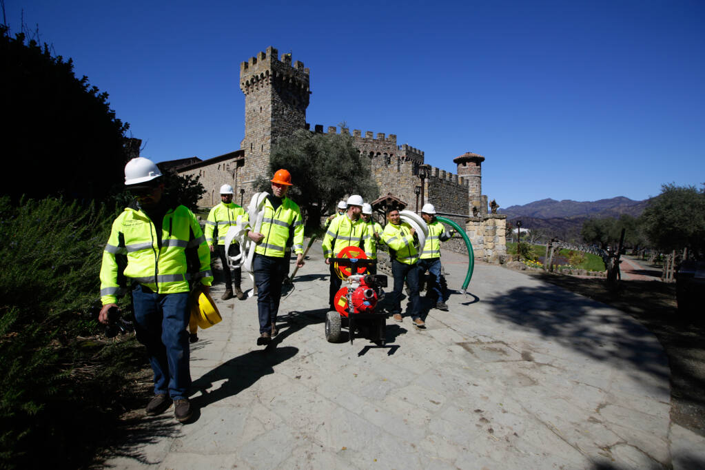 "After the 2020 Glass Fire destruction of the Farmhouse wine warehouse on the property, Castello di Amorosa (""Castle of Love"") winery near Calistoga early this year formed a fire brigade to prepare the property for high fire danger and help stage the hoses and water resources firefighters need to battle resulting blazes. The team, seen here near the winery castle on March 11, is called Cavalieri del Fuoco, which means the ""Knights of Fire"" in Italian. (courtesy of Castello di Amorosa)"