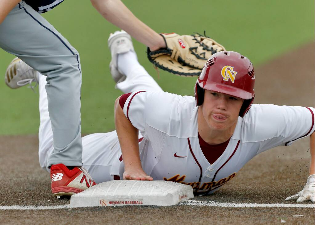 Cardinal Newman's Nathan Phelps dives safely back to first base during a game between Rancho Cotate and Cardinal Newman high schools in Santa Rosa on Friday, March 13, 2020. (Alvin Jornada / The Press Democrat)