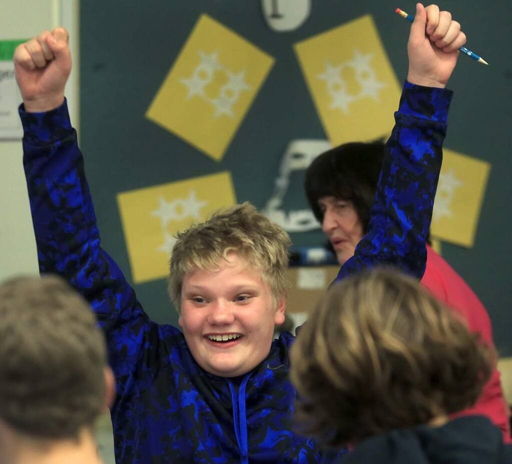Kai Alexander exults after getting a correct answer in Carol Ann Street's algebra class, background, Thursday March 16, 2017 at Petaluma Jr. High School. street says 'I want them to learn in seventh grade that they can do math, this is the year we make or break 'em. I don't want them to leave here thinking they cant do math.' (Kent Porter / The Press Democrat) 2017